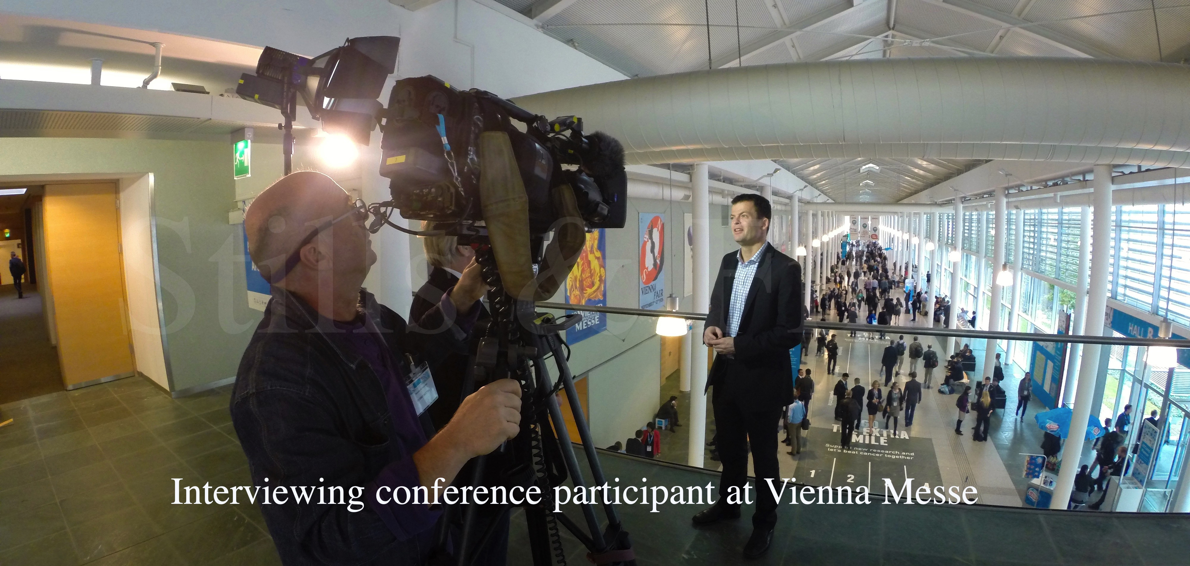 Interviewing conference participant at Vienna Messe