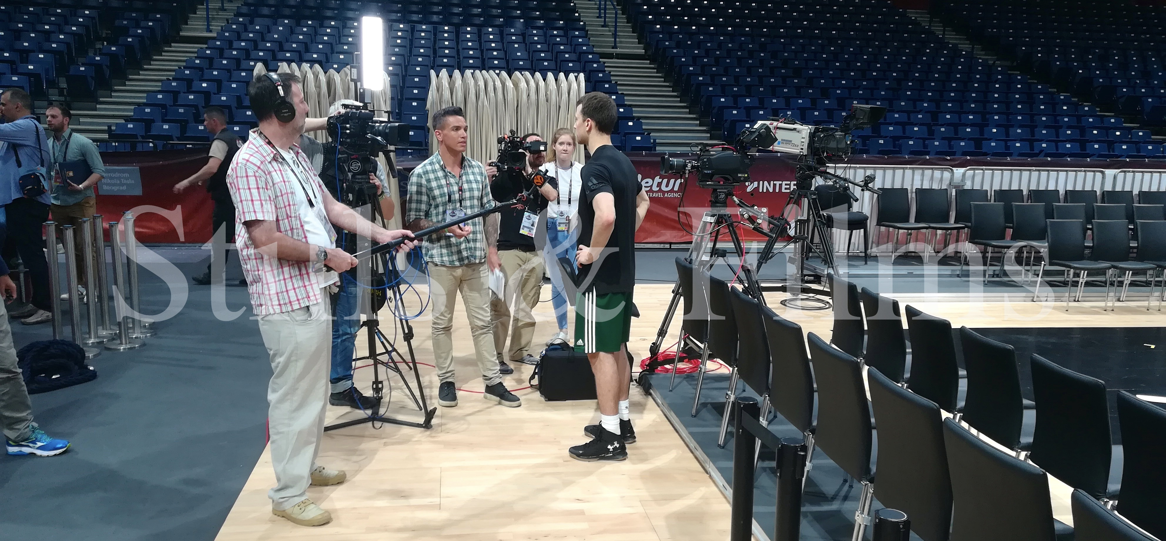 Video Crew Belgrade sound recordist working with IMG crew on a Final 4 basketball tournament